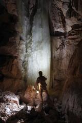 Caver in  Dachstein Mammut Cave. Austria.