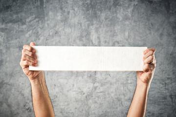 Man holding white banner