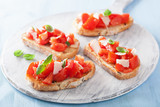 Italian bruschetta with tomatoes, parmesan, garlic and olive oil