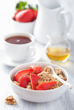 healthy breakfast with granola and strawberry