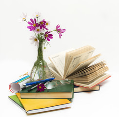 School subjects and flowers in a vase.