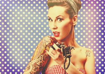 Photo of beautiful pin-up girl with tattoos