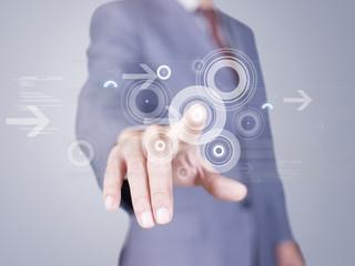 business person pressing a virtual button