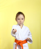 Girl with orange belt is hitting right hand