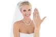 Happy bride showing wedding ring over white background