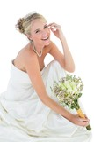 Happy bride holding flower bouquet