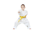 With yellow belt a little sportwoman is beating punch hand