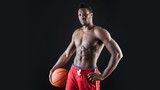 Portrait of confident young black man shirtless with basket ball