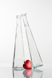 (Couple in Love) Two glasses and red heart on a glass table