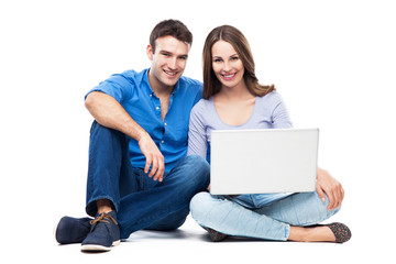 Couple sitting with laptop