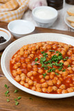 chickpeas stewed in tomato sauce, vertical