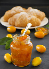 Jam of kumquats with croissant for breakfast.
