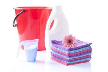 soft washing detergents with red bycket and fresh towels