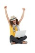 Cheerful young woman with laptop raising hands