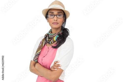 Portrait of a cool young woman with arms crossed