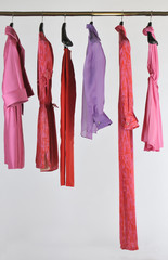 Hangers with woman clothes