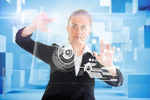 Blonde businesswoman touching interface