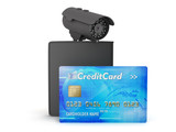 Credit card, leather wallet and video surveillance camera