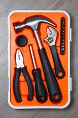 orange tools box against wooden background