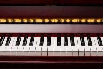 ebony and ivory keys of red piano