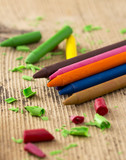 Colorful crayons on wooden table