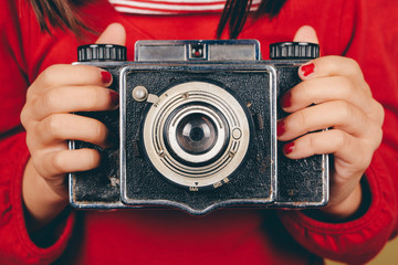 Old camera in little girl hands