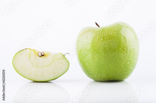 Green Granny Smith apple with waterdrops