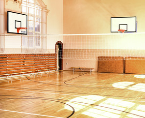 Empty School gym with basketball boards