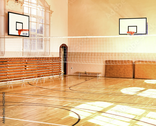 Fotobehang Wand Empty School gym with basketball boards