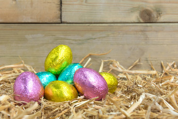Foil covered Easter eggs in a barn