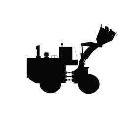 bulldozer with full bucket in silhouette