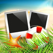 Summer holiday background with photo frames on the sand
