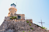 Lighthouse on the rock, the island of Corfu, Greece, Europe
