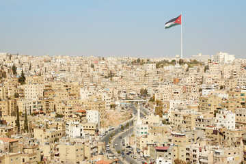 Amman city view with big Jordan flag