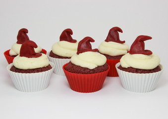 Isolated red velvet cupcakes with cream cheese frosting