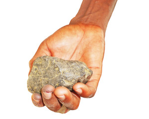 A piece of coltan ore in Congolese hand