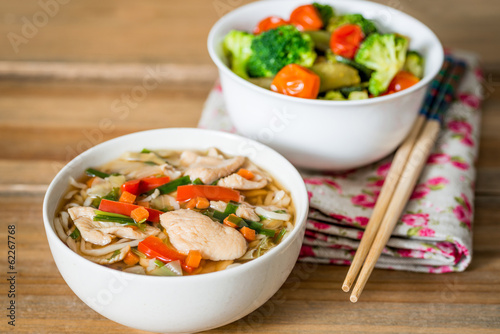 Asian soup noodles and vegetables with Chopstick