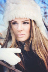 Gorgeous winter woman with white fur hat