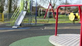 Slow spinning roundabout in an empty playground