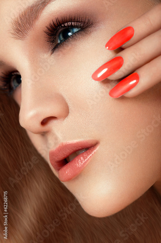 Manicure and Make-up. Beautiful Woman With Red Nails and Luxury