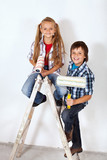 Happy painter kids on a ladder