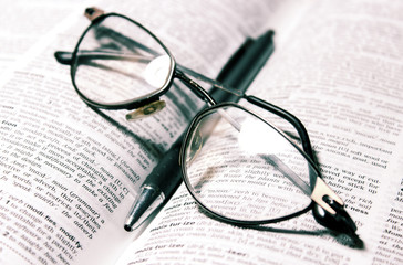 Glasses, book and pen