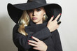 Beautiful Blond Woman in Hat.Lady in Topcoat.Spring Collection