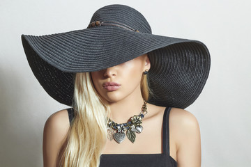 Beautiful Blond Woman in Black Hat.Spring.Accessories.Jewelry