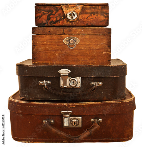 Old suitcases and boxes stacked. Isolated on white background