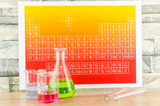 Laboratory glassware and periodic table of elements.