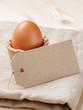 brown egg in handmade holder