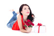 young beautiful daydreaming woman lying with gift box and flower