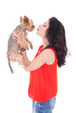 beautiful woman kissing his little dog yorkshire terrier isolate