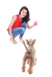 beautiful woman playing with little dog yorkshire terrier isolat